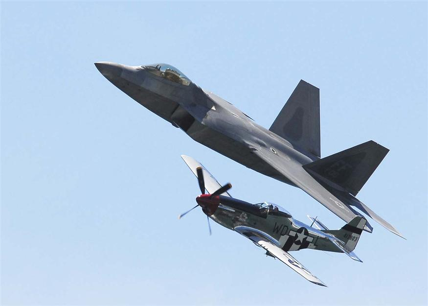 An F-22 Raptor and P-51 Mustang